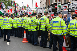 "London, July 5th 2014. Police struggle to contain crowdsas hundreds protest near the Israeli embassy in London against the ongoing occupation of Palestine and the west's support of ""Israel's collective punishment of Palestinians""."