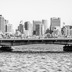 Boston skyline black and white panorama photo with Harvard Bridge and the Boston Back Bay along the Charles River. Boston Massachusetts is a major city in the Eastern United States of America. Copyright ⓒ Paul Velgos with All Rights Reserved.