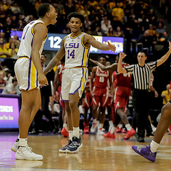 Jan 8, 2019; Baton Rouge, LA, USA; LSU Tigers guard Ja'vonte Smart (1) reacts with teammates guard Marlon Taylor (14) and forward Darius Days (22) after a three point basket against the Alabama Crimson Tide during the first half at the Maravich Assembly Center. Mandatory Credit: Derick E. Hingle-USA TODAY Sports