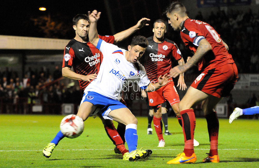 Conor Chaplin trying to force his way through during the Sky Bet League 2 match between Crawley Town and Portsmouth at the Checkatrade.com Stadium, Crawley, England on 18 August 2015. Photo by Michael Hulf.