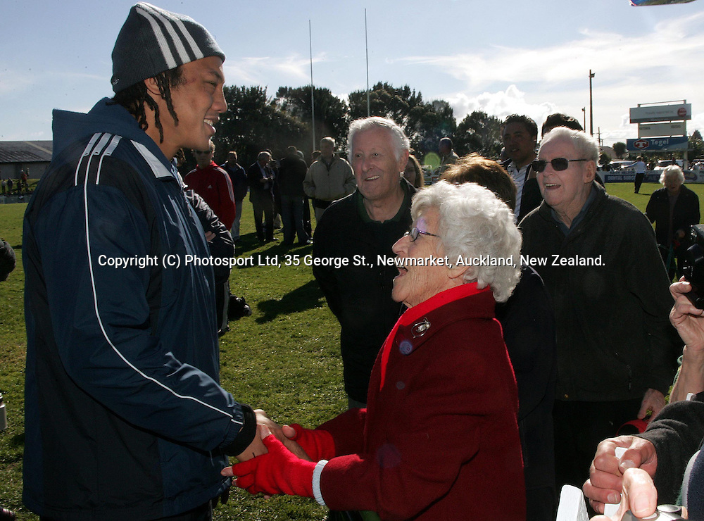 All Blacks captain, Tana Umaga meets the fans who turned out to watch the All Blacks training session at Waitemata Rugby Club, Henderson on Monday 14 June, 2004. <br />