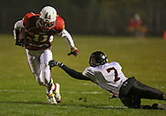 Marion's Quinn Cannoy (11) pulls away from Solon's Riley Takes (7) after a catch during the first half of the game between the Solon Spartans and the Marion Indians at Thomas Park Field in Marion on Friday evening, October 5, 2012.