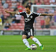 Picture by Richard Land/Focus Images Ltd +44 7713 507003<br /> 27/08/2013<br /> Danny Fox of Southampton in action during the Capital One Cup match at Oakwell, Barnsley.