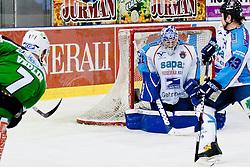 Domen Vedlin (HDD Tilia Olimpija, #7) vs Adam Munro (SAPA Fehervar AV19, #51) during ice-hockey match between HDD Tilia Olimpija and SAPA Fehervar AV19 at sixth match in Quarterfinal  of EBEL league, on March 1, 2012 at Hala Tivoli, Ljubljana, Slovenia. HDD Tilia Olimpija won 4:3 and advanced to semifinal. (Photo By Matic Klansek Velej / Sportida)