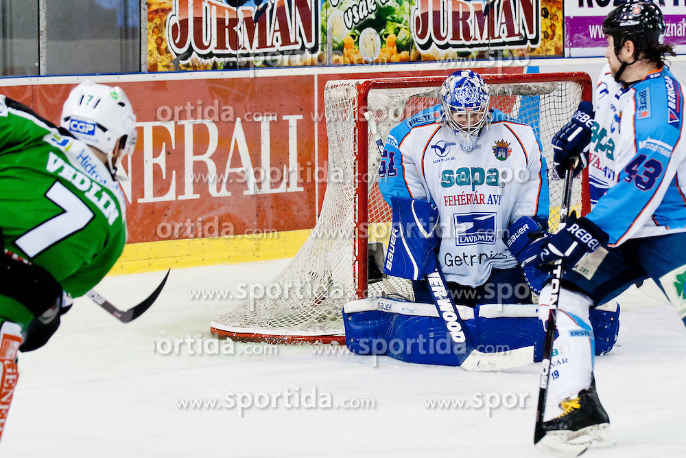Domen Vedlin (HDD Tilia Olimpija, #7) vs Adam Munro (SAPA Fehervar AV19, #51) during ice-hockey match between HDD Tilia Olimpija and SAPA Fehervar AV19 at sixth match in Quarterfinal  of EBEL league, on March 1, 2012 at Hala Tivoli, Ljubljana, Slovenia. HDD Tilia Olimpija won 4:3 and advanced to semifinal. (Photo By Matic Klansek Velej / Sportida)
