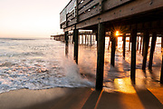 NC00773-00...NORTH CAROLINA - Sunrise and surging tide at the Nags Head Pier on the Outer Banks.