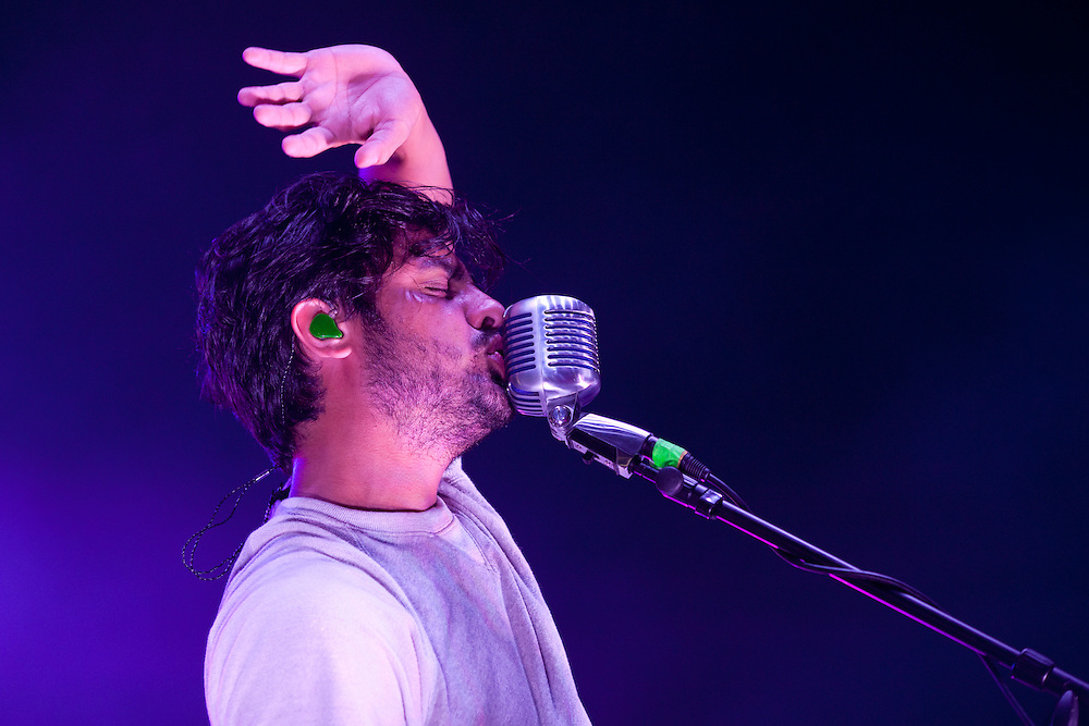 Sameer Gadhia of Young the Giant performs the headlining show at the NewBo Music Fest in downtown Cedar Rapids on Saturday, August 8, 2015. The lawn of the NewBo City Market was packed with fans and NewBo business owners hope the first-time fest will eventually span two days and bring even more alternative headliners to the area. (Rebecca F. Miller/Freelance for the Gazette)