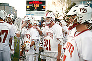 SHOT 5/11/13 7:45:30 PM - Denver's Jack Pruitt #21 and teammates were all smiles after beating the University at Albany after their first round NCAA Tournament lacrosse game at the Peter Barton Lacrosse Stadium on the University of Denver campus Saturday May 11, 2013. The University of Denver won the game 19-14 to advance. (Photo by Marc Piscotty / © 2013)