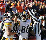 DENVER - JANUARY 22:  Wide receiver Cedrick Wilson #80 and Hines Ward #86 of the Pittsburgh Steelers celebrate after Wilson catches a 12 yard touchdown pass in the second quarter against the Denver Broncos in the AFC championship game on January 22, 2006 at INVESCO Field at Mile High in Denver, Colorado. The Steelers defeated the Broncos 34-17. ©Paul Anthony Spinelli *** Local Caption *** Cedrick Wilson;Hines Ward
