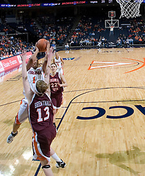 Virginia's Lyndra Littles (1) gets a shot off over VT's Elanor Brentnall (13).  The Virginia Tech Hokies overcame a 14 point Virginia lead to beat the Cavaliers 60-58 on their home court at the John Paul Jones Arena in Charlottesville, VA.
