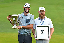 May 5, 2019 - Charlotte, NC, U.S. - CHARLOTTE, NC - MAY 05: Max Homa and his caddie Joe Greiner pose for a photo with their trophies after winning the Wells Fargo Championship on May 05, 2019 at Quail Hollow Club in Charlotte,NC. (Photo by Dannie Walls/Icon Sportswire) (Credit Image: © Dannie Walls/Icon SMI via ZUMA Press)