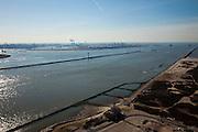 Nederland, Hoek van Holland, Noorderhoofd, 20-03-2009; ingang Nieuwe Waterweg met in de voorgrond de Verkeerscentrale Hoek van Holland, onderdeel van de Kustwacht. Officiele namen van deze dienst: VCH (Verkeers Centrale Hoek) of  TCH (Traffic Center Hook). Aan de horizon de Maasvlakte met de elektriciteitscentrale van E.ON (EON).Entrance of the Nieuwe Waterweg, in the front the traffic control centre of Hoek van Holland, part of the Coast Guard. Official names of the service: VCH (in Dutch) or TCH (Traffic Center Hook). On the skyline the Maasvlakte and the power plant of E. ON (EON).Swart collectie, luchtfoto (toeslag); Swart Collection, aerial photo (additional fee required); .foto Siebe Swart / photo Siebe Swart