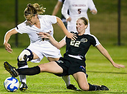 Army midfielder Sarah Goss (22) battles with Virginia Cavaliers midfielder/forward Kelly Quinn (10).  The #16 ranked Virginia Cavaliers defeated the Army Black Knights 2-0 in the first round of NCAA Division 1 Women's Soccer Tournament at Klockner Stadium on the Grounds of the University of Virginia in Charlottesville, VA on November 14, 2008.
