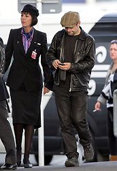 Hobbit actor, Andy Serkis walks and texts between flights after arriving  on a flight form Los Angeles, Auckland, New Zealand, Sunday, November 25, 2012. Credit: SNPA /  Simon Runting