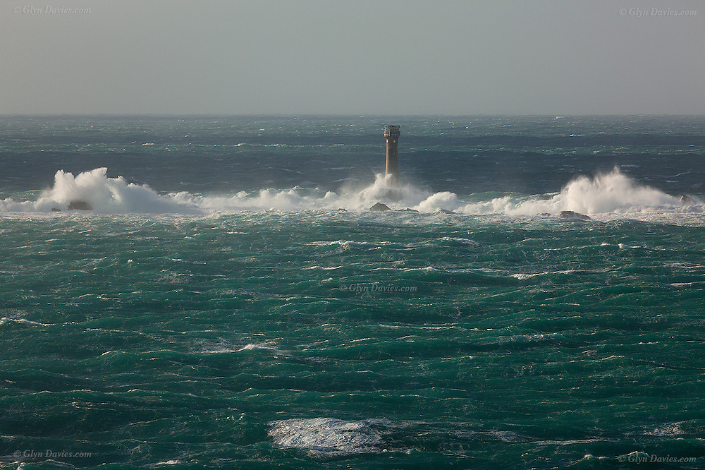 "Storm waves crash onto the reef just 1 mile West of Land's End, the most South Westerly point of Cornwall and indeed the British Isles. This large and treacherous Longships reef is marked by the 35meter high ""Longships Lighthouse"" (1795) who's light reaches 15 nautical miles."