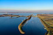 Nederland, Noord-Brabant, Willemstad, 07-02-2018; Volkeraksluizen, de schutsluizen met drie kolken en onder de brug van de A 29, de spuisluizen. Op het Knooppunt Hellegatsplein (links) splitst de snelweg, naar links de N 59, naar Goeree-Overflakkee via de Hellegatsdam, naar rechts de A29 naar de Haringvlietbrug.<br /> De Volkeraksluizen - in de Volkerakdam - verbinden het Hollandsch Diep met het Volkerak en maken deel uit van de Deltawerken.<br /> Volkerak Locks, largest inland navigation locks in Europe, part of the Deltaworks<br /> luchtfoto (toeslag op standard tarieven);<br /> aerial photo (additional fee required);<br /> copyright foto/photo Siebe Swart