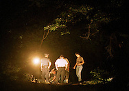 c nbody Bill Cain north, 7/22/96, Bristol Twp., PA..An unidentified body was found at about 5PM Monday afternoon at a park adjacent to the Burlington Bristol Bridge in Bristol Twp., PA.. In photo: Police officers collect evidence from the wooded crime scene while investigating.