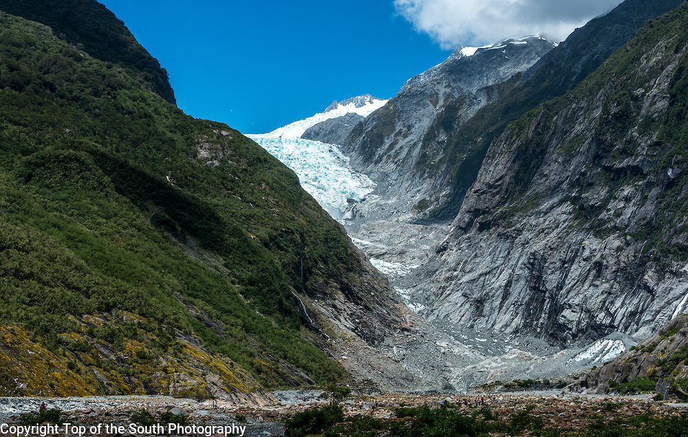 The Franz Josef (Ka Roimata o Hinehukatere in Māori)is a 12 km (7.5 mi) long glacier located in Westland Tai Poutini National Park on the West Coast of New Zealand's South Island. Together with the Fox Glacier 20 km (12 mi) to the south, it is unique in descending from the Southern Alps to less than 300 metres (980 ft) above sea level, amidst the greenery and lushness of a temperate rainforest.<br />