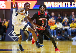 Dec 22, 2018; Morgantown, WV, USA; Jacksonville State Gamecocks center Ty Hudson (4) dribbles past West Virginia Mountaineers forward Wesley Harris (21) during the first half at WVU Coliseum. Mandatory Credit: Ben Queen-USA TODAY Sports