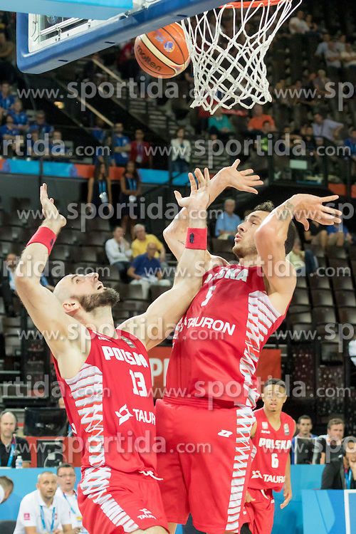 06.09.2015, Park Suites Arena, Montpellier, FRA, Russland vs Polen, Gruppe A, im Bild MARCIN GORTAT (13), AARON CEL (5) // during the FIBA Eurobasket 2015, group A match between Russia and Poland at the Park Suites Arena in Montpellier, France on 2015/09/06. EXPA Pictures &copy; 2015, PhotoCredit: EXPA/ Newspix/ Pawel Pietranik<br /> <br /> *****ATTENTION - for AUT, SLO, CRO, SRB, BIH, MAZ, TUR, SUI, SWE only*****
