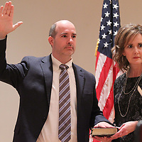 Bradley Tennison takes the oath of office to become the next Chancery Judge Friday morning in Booneville.