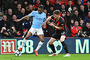 Raheem Sterling (7) of Manchester City battles for possession with Chris Mepham (33) of AFC Bournemouth  during the Premier League match between Bournemouth and Manchester City at the Vitality Stadium, Bournemouth, England on 2 March 2019.