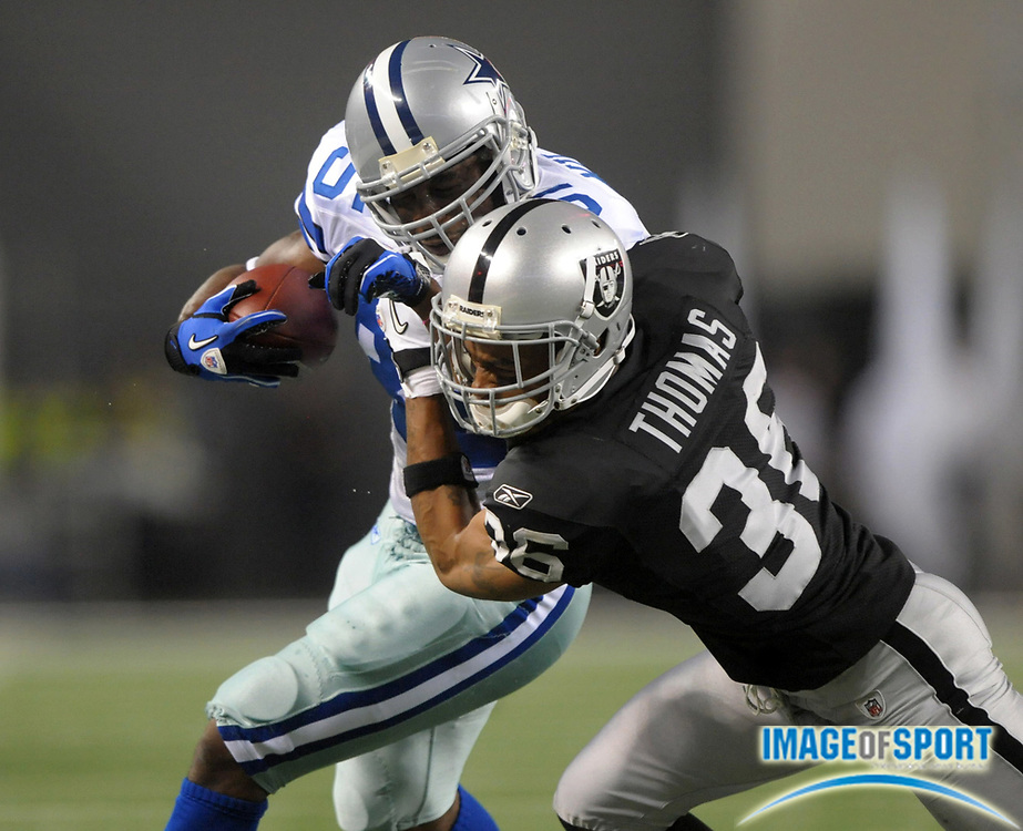 Aug 12, 2010; Arlington, TX, USA; Dallas Cowboys running back Lonyae Miller (35) is tackled by Oakland Raiders cornerback Joey Thomas (35) during the preseason game at Cowboys Stadium. Photo by Image of Sport