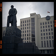 A statue of the founder of the Soviet Union, Vladimir Ilyich Lenin, stands in front of the main government building on Independence Square in Minsk.
