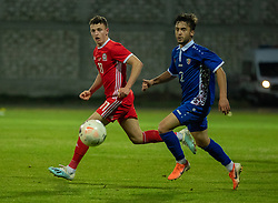 ORHEI, MOLDOVA - Friday, October 11, 2019: Wales' Nathan Broadhead (L) and Moldova's Vladislav Boico during the UEFA Under-21 Championship Italy 2019 Qualifying Group 9 match between Moldova and Wales at the Orhei District Sports Complex. (Pic by Kunjan Malde/Propaganda)