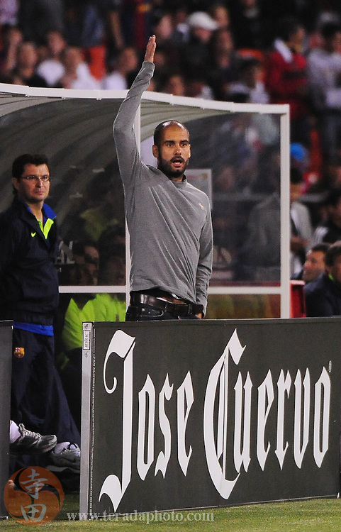August 8, 2009; San Francisco, CA, USA; FC Barcelona head coach Josep Guardiola argues a call during the first half against Chivas de Guadalajara in the Night of Champions international friendly contest at Candlestick Park.