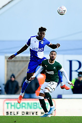 Rollin Menayese of Bristol Rovers contends for the aerial ball with Byron Moore of Plymouth Argyle - Mandatory by-line: Ryan Hiscott/JMP - 01/12/2019 - FOOTBALL - Memorial Stadium - Bristol, England - Bristol Rovers v Plymouth Argyle - Emirates FA Cup second round