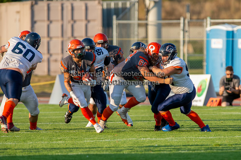 KELOWNA, BC - AUGUST 3:  Kelton Kouri #38 runs through an opening as JJ Heaton #62 of Okanagan Sun blocks a player of the Kamloops Broncos at the Apple Bowl on August 3, 2019 in Kelowna, Canada. (Photo by Marissa Baecker/Shoot the Breeze)
