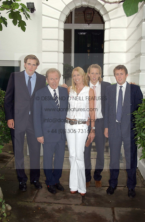 SIR DAVID & LADY CARINA FROST with their sons, left to right, WILFRED FROST, GEORGE FROST and MILES FROST at Sir David & Lady Carina Frost's annual summer party held in Carlyle Square, Chelsea, London on 5th July 2006.<br /><br />NON EXCLUSIVE - WORLD RIGHTS
