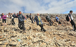 Pilgrims and climbers make their way down the slopes of Croagh Patrick.<br /> Pic Conor McKeown