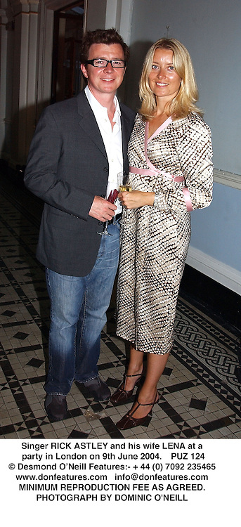 Singer RICK ASTLEY and his wife LENA at a party in London on 9th June 2004.<br /> PUZ 124