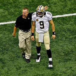 September 23, 2012; New Orleans, LA, USA; New Orleans Saints defensive coordinator Steve Spagnuolo and quarterback Drew Brees (9) prior to kickoff of a game against the Kansas City Chiefs at the Mercedes-Benz Superdome. Mandatory Credit: Derick E. Hingle-US PRESSWIRE