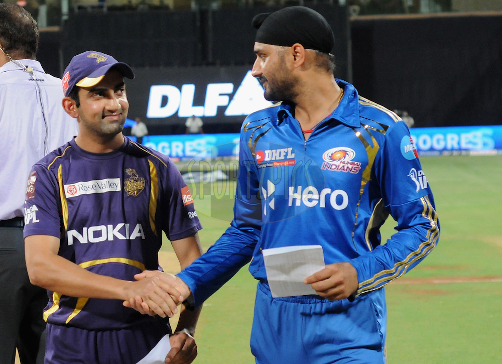Gautam Gambhir captain of Kolkatta Knight Riders and Harbhajan Singh captian of Mumbai Indians during the toss before the start of the match 65 of the Indian Premier League ( IPL) 2012  between The Mumbai Indians and the Kolkata Knight Riders held at the Wankhede Stadium in Mumbai on the 16th May 2012..Photo by Pal Pillai/IPL/SPORTZPICS.