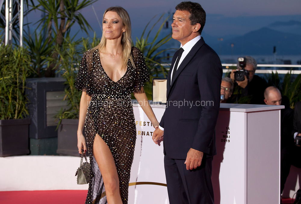 Antonio Banderas, winner of the Best Actor award for the film Dolor Y Gloria (Pain and Glory) with Nicole Kimpel at the Palme D'Or Award photo call at the 72nd Cannes Film Festival, Saturday 25th May 2019, Cannes, France. Photo credit: Doreen Kennedy