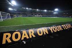 A general view of a barrier reading Roar On Your Team! at the KCOM stadium