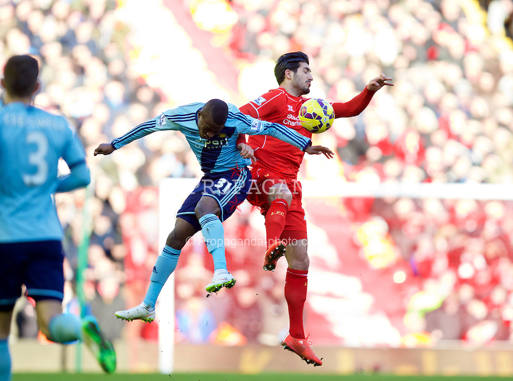 LIVERPOOL, ENGLAND - Saturday, January 31, 2015: Liverpool's Emre Can and West Ham United's Enner Valencia during the Premier League match at Anfield. (Pic by David Rawcliffe/Propaganda)