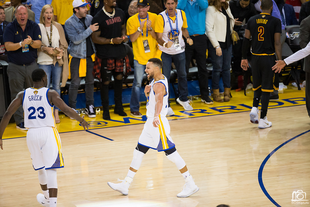 Golden State Warriors guard Stephen Curry (30) celebrates a basket during Game 2 of the NBA Finals against the Cleveland Cavaliers at Oracle Arena in Oakland, Calif., on June 4, 2017. (Stan Olszewski/Special to S.F. Examiner)