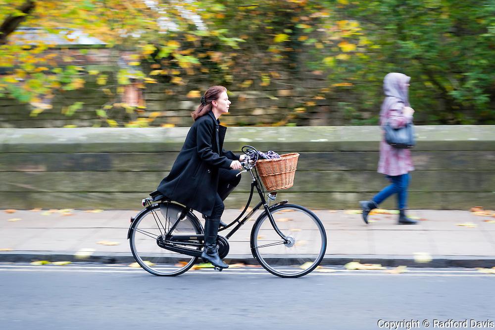 Woman on bicycle, York, England, UK