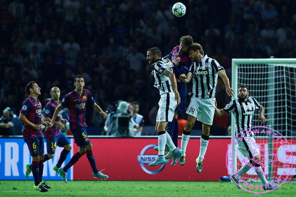Gerard Pique of FC Barcelona fights for the ball with Andrea Barzagli and Fernando Llorente both from Juventus during the 2014/15 UEFA Champions League Final between Juventus and FC Barcelona at Olympiastadion on June 6, 2015 in Berlin, Germany.<br /> Germany, Berlin, June 6, 2015<br /> <br /> Picture also available in RAW (NEF) or TIFF format on special request.<br /> <br /> For editorial use only. Any commercial or promotional use requires permission.<br /> <br /> Adam Nurkiewicz declares that he has no rights to the image of people at the photographs of his authorship.<br /> <br /> Mandatory credit:<br /> Photo by &copy; Adam Nurkiewicz / Mediasport