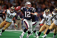 New England Patroits Tom Brady plays in Super Bowl XXXVI against the St.Louis Rams at the Louisiana Superdome on February 3,2002 in New Orleans, Louisiana.The Patriots defeated the Rams 20-17.<br />  (AP Photo/Tom DiPace)