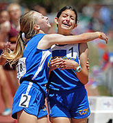 jt050518c/sports/jim thompson/ left to right-Cottonwood Classic's Rhylyn Jones(2nd place) throws her arms around teammate Jordyn Tatum after they finished first and second in the Girls 800 Meter Run.  Saturday, May. 05,  2018. (Jim Thompson/Albuquerque Journal)