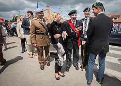 © Licensed to London News Pictures. 05/06/2014.  D Day Veterans and a serving British soldier take some time out as they attend a service at  Pegasus Bridge for the 70th Anniversary of the D Day landings in Normandy.  Photo credit : Alison Baskerville/LNP