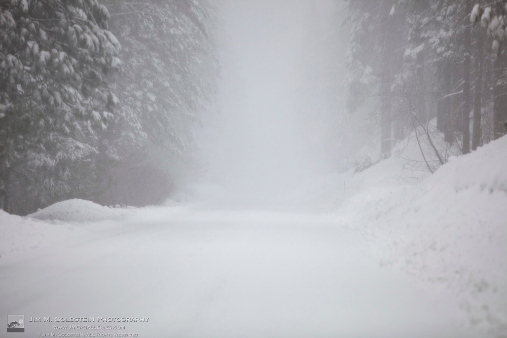 Extreme road conditions with fog and heavy snow in Yosemite National Park, California