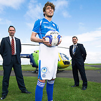 St Johnstone FC support Scotland's Charity Air Ambulance (SCAA) by wearing the charities helicopter logo on their shorts for the forthcoming season, midfielder Murray Davidson is pictured at SCAA's base at Perth Airport with SCAA and St Johnstone Chairman Steve Brown (right_.<br /> for further info please contact Maureen Young on 07778 779888<br /> Picture by Graeme Hart.<br /> Copyright Perthshire Picture Agency<br /> Tel: 01738 623350  Mobile: 07990 594431