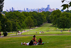 Sunbathers enjoy the hot weather at Primrose Hill as temperatures exceed 37ºC in London. London, July 25 2019.