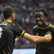 MLS Soccer- Vancouver Whitecaps FC vs. the Columbus Crew SC at BC Place Stadium in Vancouver:  Columbus Crew Kei Kamara celebrates a goal with Justin Meram
